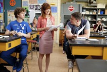COLUMBIA PICTURES - Ellie Kemper and Channing Tatum star in the new incarnation of 21 Jump Street.
