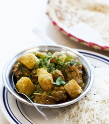 JENNIFER SILVERBERG - Spice-n-Grill's chicken vindaloo comes cooked with potatoes, tomatoes and spices.