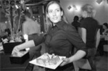 JENNIFER  SILVERBERG - Comfort sushi: Servers like Andrea Achillens bring - friendly warmth to Modai's cool interior.