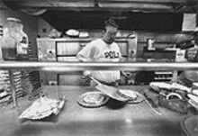 """Miguel """"Guido"""" Carretero makes the Italian food served at Guido's Pizza and Tapas."""