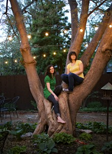 JENNIFER SILVERBERG - Cassie Morgan and Beth Bombara climb a tree — but not a pine tree.