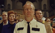 FOCUS FEATURES - Bruce Willis, center, as Captain Sharp