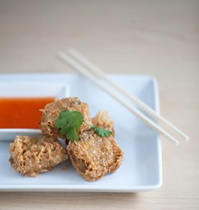 JENNIFER SILVERBERG - From the appetizer menu, Hoy Jaw. Deep-fried dumplings with crab and shrimp mixed with minced pork, wrapped in tofu skin, and served with a Thai sweet chili sauce. Slideshow: Photo tour of Fork & Stix