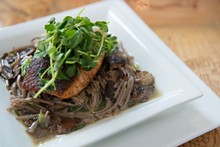 COREY WOODRUFF - Porcini Salmon:  Salmon over soba noodles in a mushroom Dashi with pea shoots. Slideshow: Inside Robust on Washington Avenue.