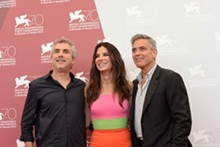 VENICE INTERNATIONAL FILM FESTIVAL MEDIA CENTER - Alfonso Cuarón, Sandra Bullock, and George Clooney in Venice for the screening of Gravity.