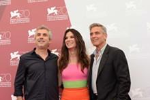 VENICE INTERNATIONAL FILM FESTIVAL MEDIA CENTER - Alfonso Cuarón, Sandra Bullock, and George Clooney in Venice for the screening of Gravity.