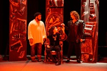 JOEY RUMPELL - Faustus (Ashley Bauman, center) heeds the Seven (Nicole Angeli, left) while her former tormentor (Kareem Deanes, right) awaits his fate.