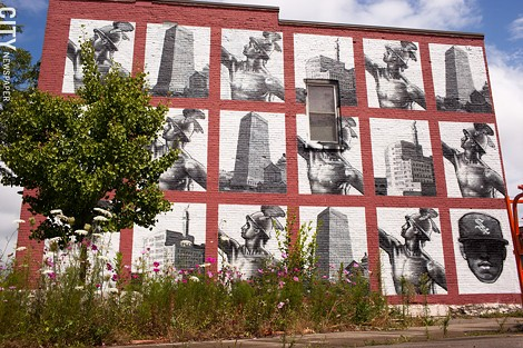 "2013 mural ""Commerce Moves Swifter Than Culture,"" by Gaia on the South Wedge Planning Committee building at 224 Mt. Hope Avenue. - FILE PHOTO"
