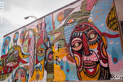 "2013 mural, ""Understand,"" by Adam Francey on the south side of Personal Fx Hair Studio on - South Avenue. - FILE PHOTO"