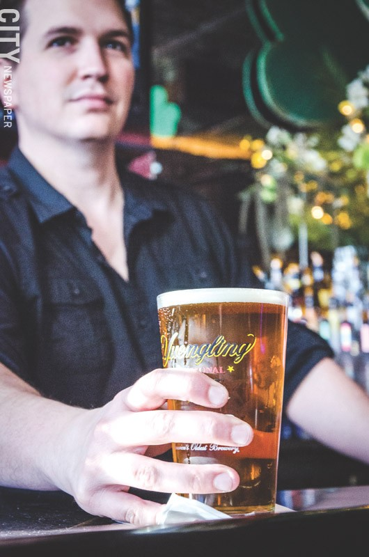 A bartender serves up a cold pint at Avenue Pub. - PHOTO BY MARK CHAMBERLIN