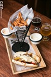 A Belgian sausage sandwich with frites from Victoire.