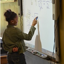 A city school student at work in the classroom. - FILE PHOTO