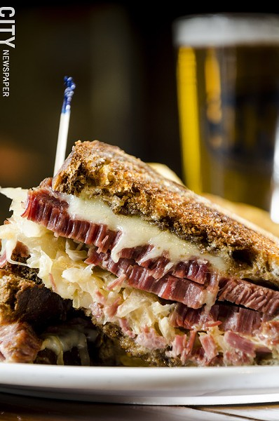 A Reuben sandwich with house-brined corned beef, sauerkraut, swiss cheese & - Thousand Island dressing on grilled, marbled rye. - PHOTO BY MARK CHAMBERLIN