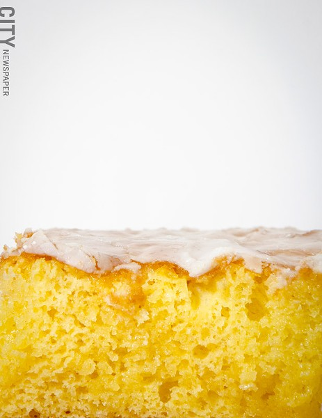A slice of lemonade cake from Kneel & Neal Southern Cuisine. - PHOTO BY MARK CHAMBERLIN