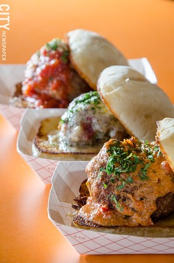 A trio of meatball sliders — pork sausage, chicken, and vegetarian — with sauces from Skylark Lounge. - PHOTO BY MARK CHAMBERLIN
