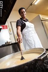 Alemnesh Mengesha stirs a pot of Kik Alicha. - PHOTO BY JOHN SCHLIA