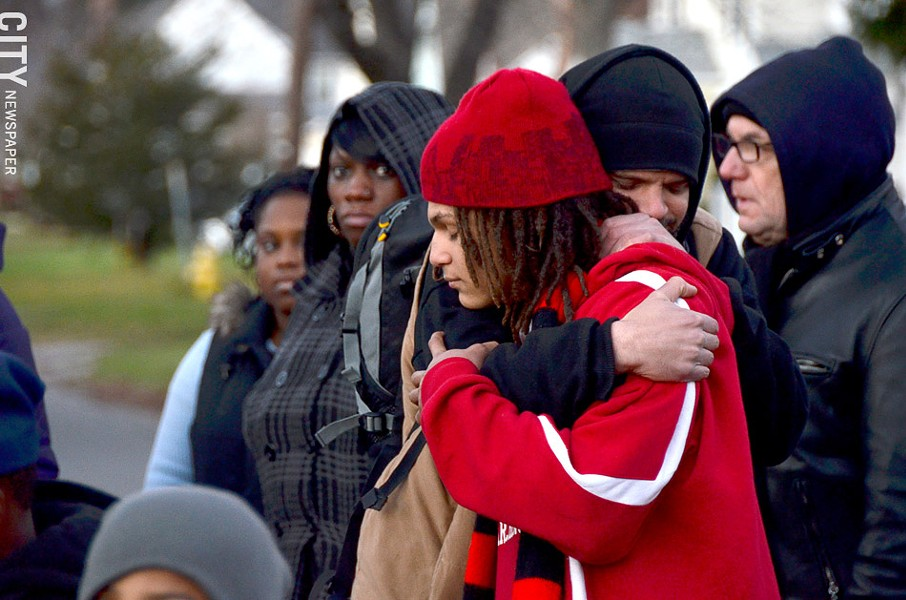 Alex Hare hugs family friend Mbele Badawi at the rally on Thursday evening. - PHOTO BY MATT DETURCK