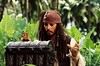 All hands on Depp: Captain Jack     Sparrow covets the <i>Dead Man's Chest</i>.