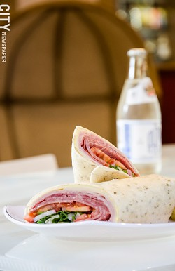 Along with a coffee menu, the recently opened Founders Café serves sandwiches, wraps, and panini, like the Italian trio wrap with an Ouzon soda. - PHOTO BY MARK CHAMBERLIN