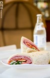 Along with a coffee menu, the recently opened Founders Café serves sandwiches, wraps, and panini, like the Italian trio wrap with an Ouzon soda.