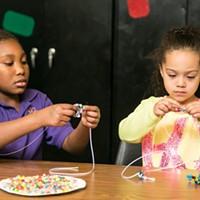 SWAN After-School Program Arah & Arjani make bead creations. PHOTO BY MIKE HANLON