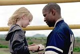 "20TH CENTURY FOX - Assassin becomes surrogate dad: Dakota Fanning and Denzel Washington in ""Man on Fire."""