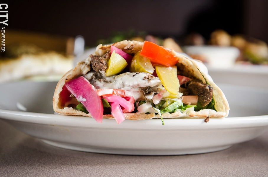 Beef Shawarma (pita bread with tomato, sumac spice, pickled turnips, and cucumbers with tahini sauce) - PHOTO BY MARK CHAMBERLIN