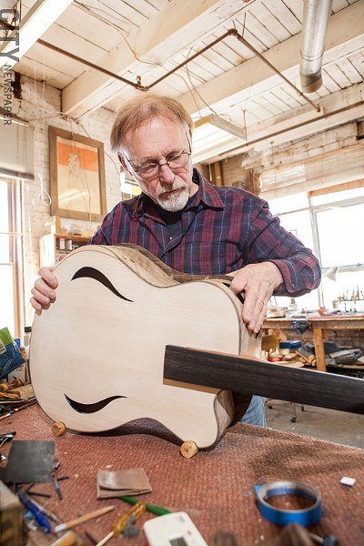 Bernie Lehmann working on a guitar. - PHOTO BY JOHN SCHLIA
