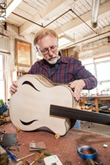 Bernie Lehmann working on a guitar. - PHOTO BY JOHN SCHLIA