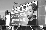 DEE KASZUBA - Billboard on South Clinton pleads for information on one of Rochester's killings.