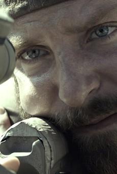 "Bradley Cooper takes aim in ""American Sniper."""