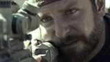 "PHOTO COURTESY WARNER BROS. - Bradley Cooper takes aim in ""American Sniper."""
