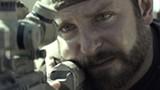 """PHOTO COURTESY WARNER BROS. - Bradley Cooper takes aim in """"American Sniper."""""""