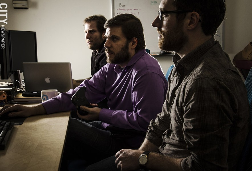 Brian Johnstone, Matthew Mikuszewski, and Colin Doody — along with Scott Flynn — co-founded Darkwind Studios while they were still students. The company now employs 15 people, most of whom are graduates from RIT. - PHOTO BY MARK CHAMBERLIN