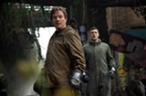 "PHOTO COURTESY WARNER BROS. - Bryan Cranston and Aaron Taylor-Johnson in ""Godzilla."""