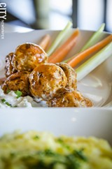 PHOTO BY MARK CHAMBERLIN - Buffalo chicken baby ball starter with bleu cheese sauce from Orbs.