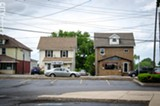 Businesses in converted houses sit across from big-box stores along some sections of East Ridge Road in Irondequoit. - PHOTO BY MARK CHAMBERLIN