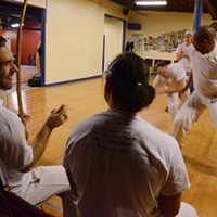 Capoeira at Com Expressao Capoeira is often practiced with traditional Brazilian berimbau music. PHOTO BY LARISSA COE