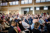Charlotte residents crammed into a May 5 meeting on the port redevelopment project. - PHOTO BY MARK CHAMBERLIN