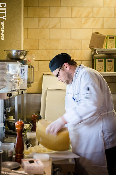 Chef Steven Terry grating fresh cheese. - PHOTO BY MARK CHAMBERLIN