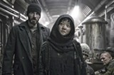 "PHOTO COURTESY THE WEINSTEIN COMPANY - Chris Evans and Ah-sung Ko in ""Snowpiercer."""