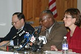 PHOTO BY KRESTIA DEGEORGE - Closing time: school-closure committee members Charles Zettek, Clifford Florence, and Jana Carlisle at Wednesdays press conference.