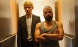 "PHOTO COURTESY A24 - Domhnall - Gleeson and Oscar Isaac in ""Ex Machina."""