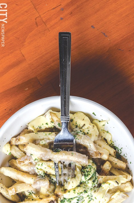 Duck fat frites, duck gravy, and First Light Creamery cheese curds makes up Lento's poutine. - PHOTO BY MARK CHAMBERLIN