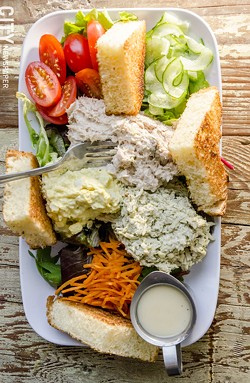 Egg salad, basil chicken salad, and tuna salad on mixed greens with toast points. - PHOTO BY MARK CHAMBERLIN