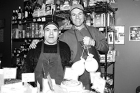 Feta accompli: Vince Giordano (right) and brother-in-law - Tony Grugnale continue to grow their international - cheese shop at the Public Market. - FRANK DE BLASE