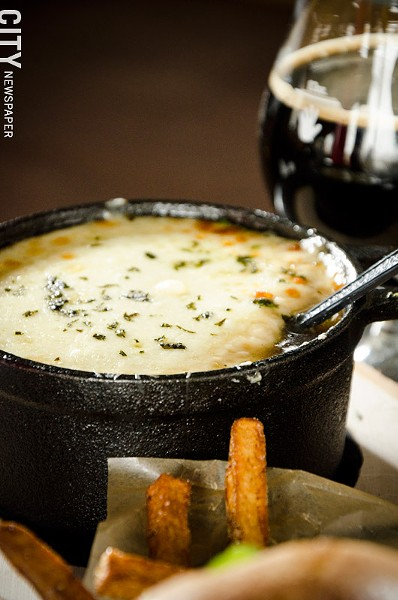 French Onion Soup with a chèvre-grilled-cheese crouton from The Angry Goat. - PHOTO BY MARK CHAMBERLIN