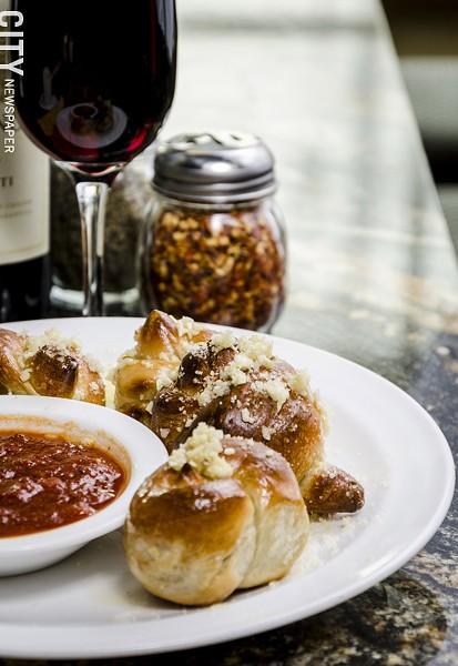 Garlic knots with marinara at Cinelli's Pizza Ristorante. - PHOTO BY MARK CHAMBERLIN