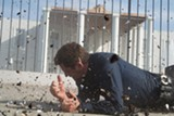 "PHOTO COURTESY OF FILMDISTRICT - Gerard Butler and an exploding White House in ""Olympus Has Fallen."""