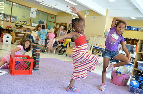 Gloria Milosevic (with blocks), Jahlyse Quick, and Kimoni Quamina have completed the city school district's prekindergartenprogram at Rochester Childfirst Network, 941 South Avenue. They will enter kindergarten this school year. - PHOTO BY MATT DETURCK